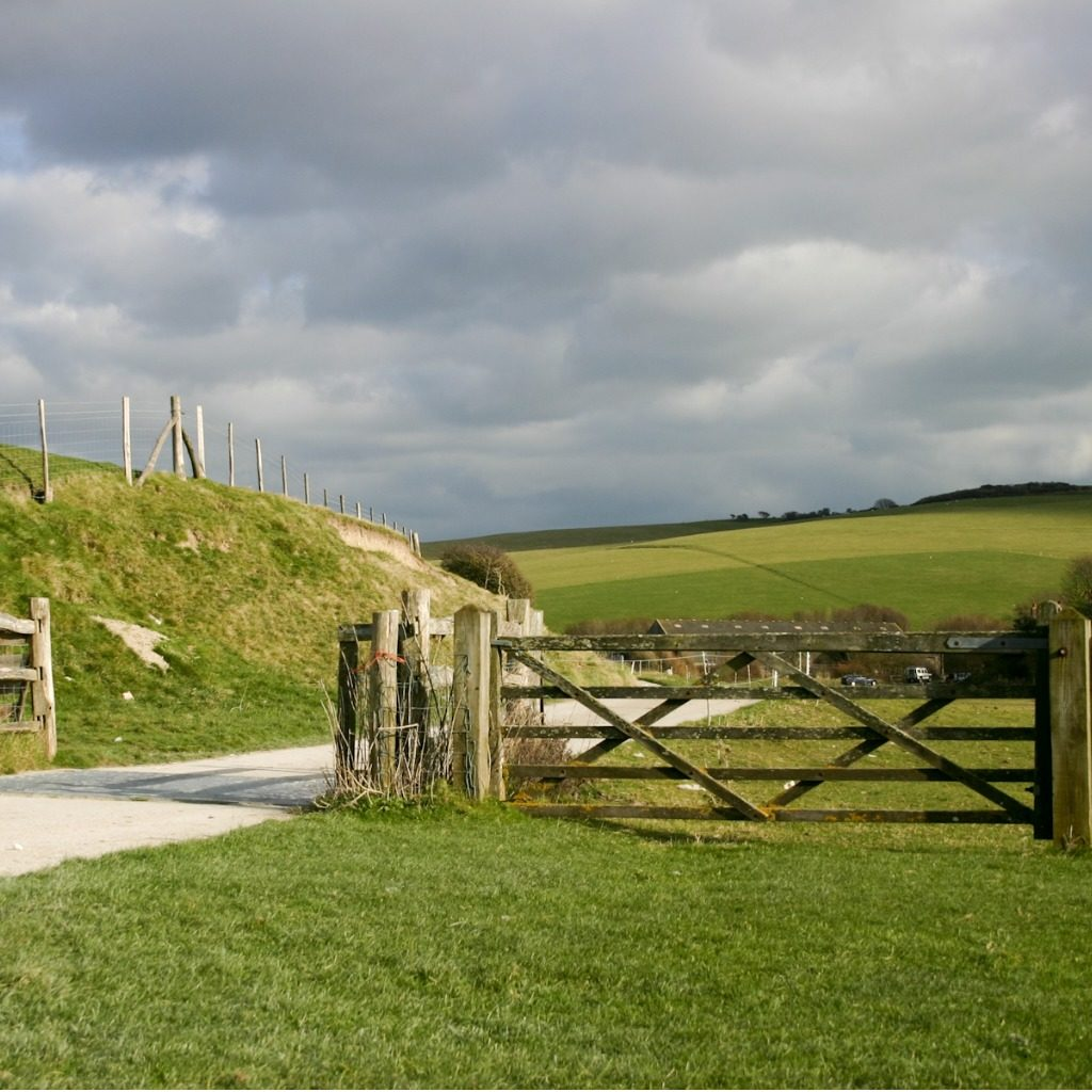 A countryside scene and gate near AS Countryside Services' office